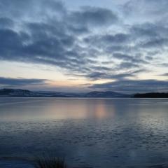 A sunset over Loch Lomond at Loch Lomond Waterfront