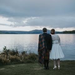 A bride and groom enjoying the views of Loch Lomond